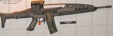 "XM8 rifle in ""sharpshooter"" (sniper) configuration. While sightlooks similar to red-dot, mounted on other variants, it is of 3.5X magnification; spare magazine is clamped to the right side of the magazine inserted into the rifle."