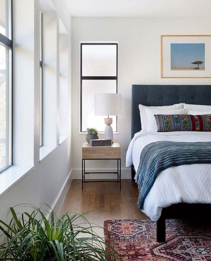 Simple Bedroom Blue And White Bedroom Hardwood Floors Natural Light Eclectic Bedroom Home Decor Bedroom Home Bedroom
