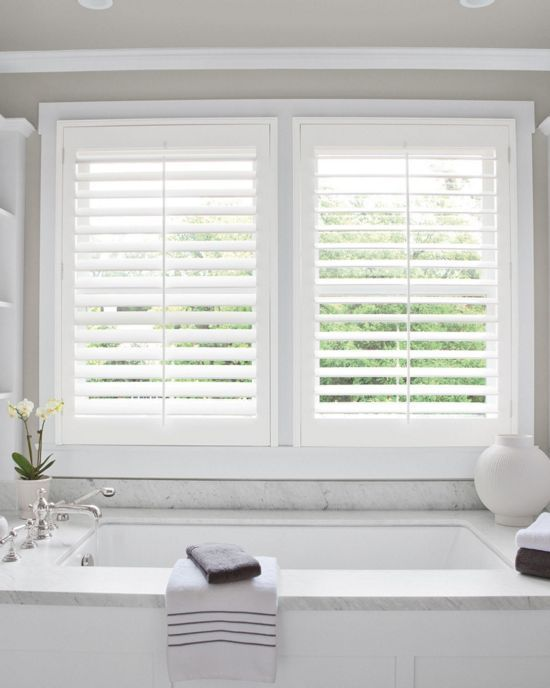 """hese beautifully styled shutters are crafted to bring you all the beauty of wood alongside superior insulation. Consider them for high-moisture areas not normally suitable for wood, like kitchens and bathrooms. The grand 3 1/2"""" louver size offers more expansive views when open."""