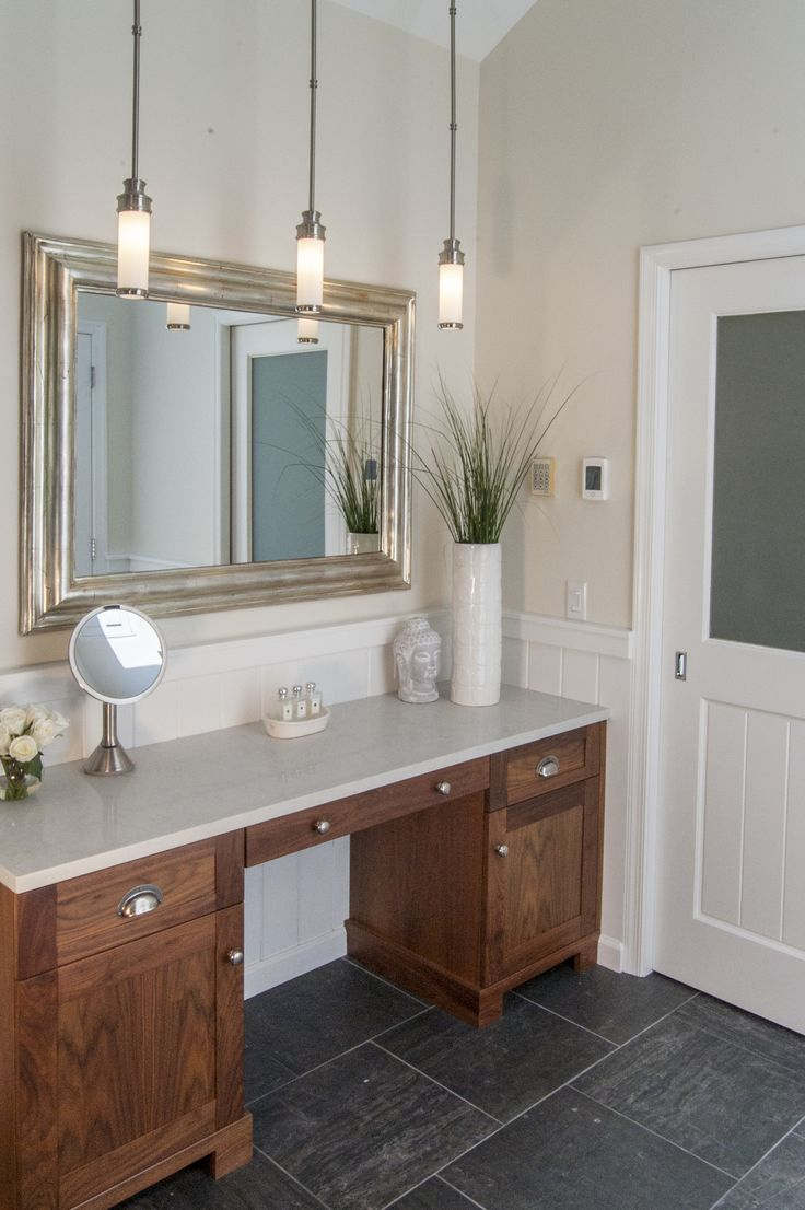 The Gardner/Fox team reconfigured the floorpan to accommodate a more spacious & luxurious master bath. The newly revamped master suite incorporates a large walk in shower with two shower heads, his & her vanities, a freestanding pedestal tub, and a makeup table with pendant lighting.