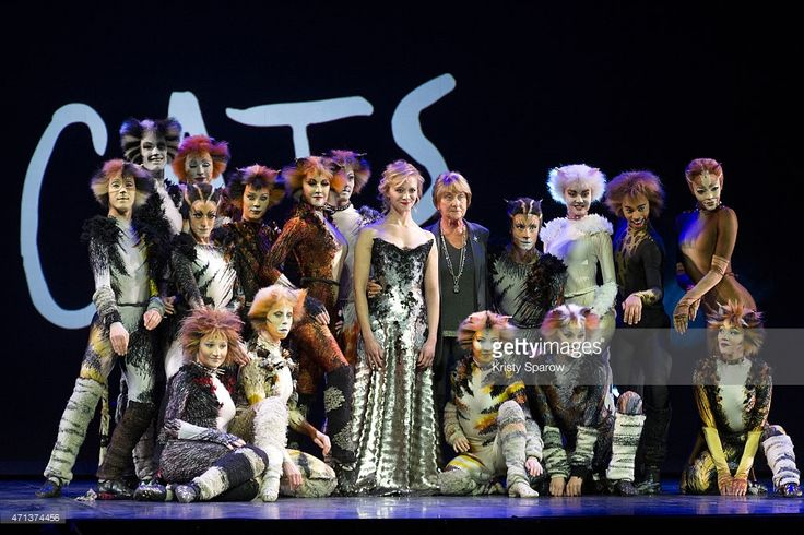 French actress Prisca Demarez and British choreographer Gillian Lynne pose with members of the cast during a press presentation of the musical 'Cats' at the Mogador Theatre on April 27, 2015 in Paris, France. Since its debut in 1981, the musical 'Cats' has risen as one of the most popular an longest-running stage shows in the world and will soon open in Paris on October 1, 2015.