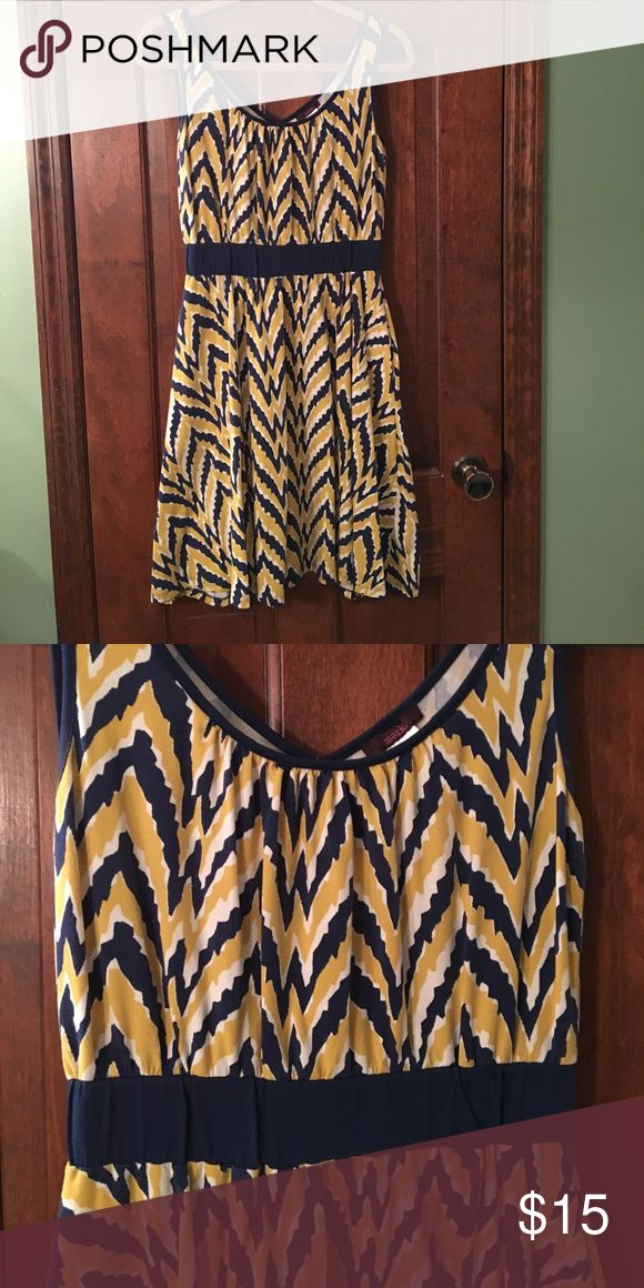 Gold and blue chevron dress with pockets Pretty gold and blue dress with pockets.  Gently used and in need of a new home.  95% cotton, 5% spandex. Avon Dresses Midi