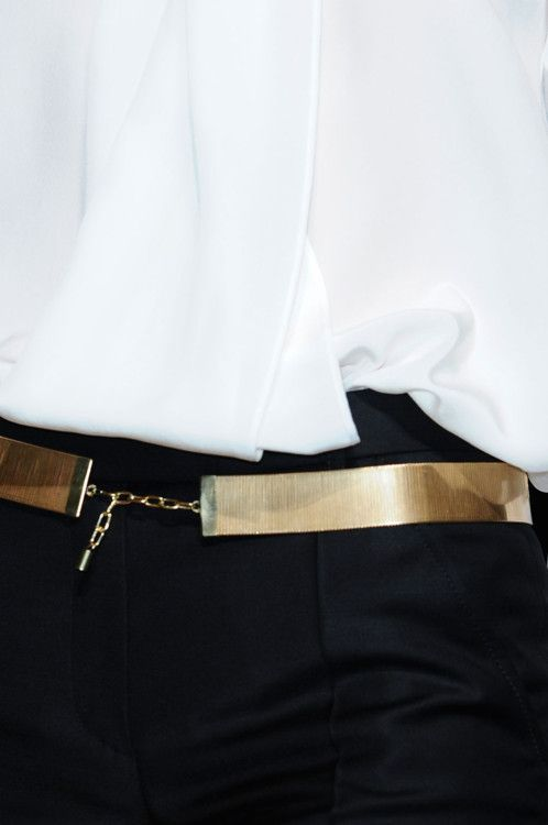 black and white with a thin gold belt.