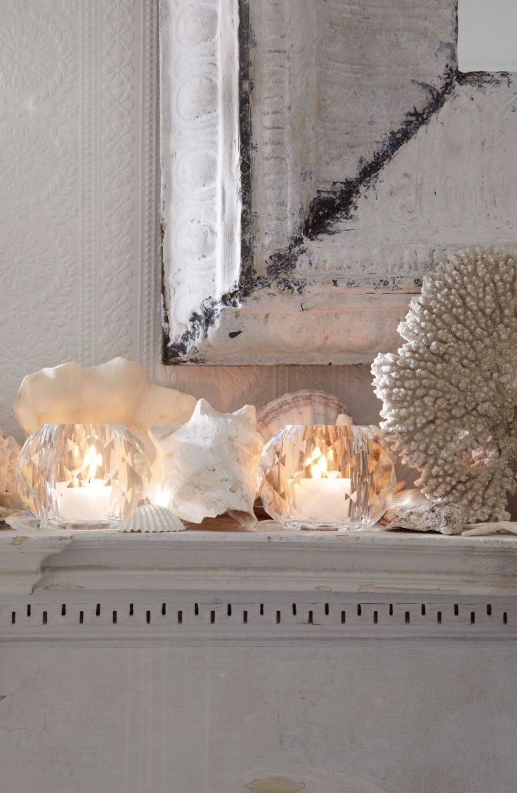 Ralph Lauren Home's Daniella crystal votives & a collection of seashells decorate the mantle of a seaside home.