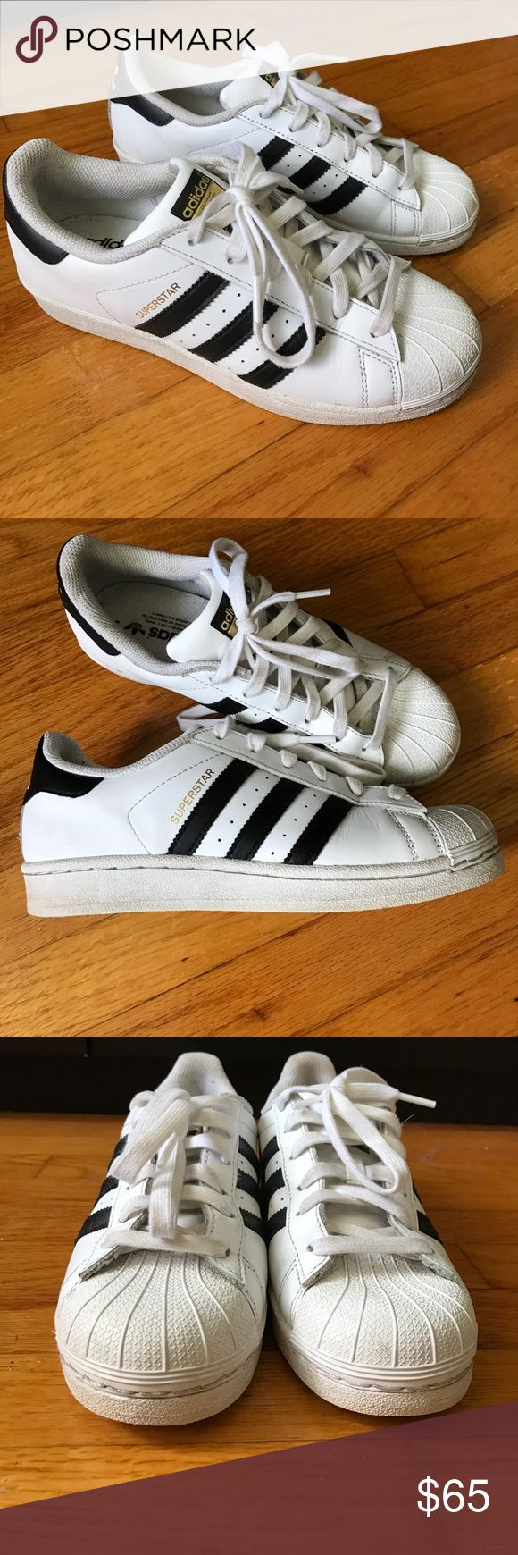 Adidas Superstar Shoes Classic white and black Adidas superstar. Worn only one day to Coachella so are in great condition despite some minor dirt/sand. Nothing a cleaning can't fix! Adidas Shoes Sneakers