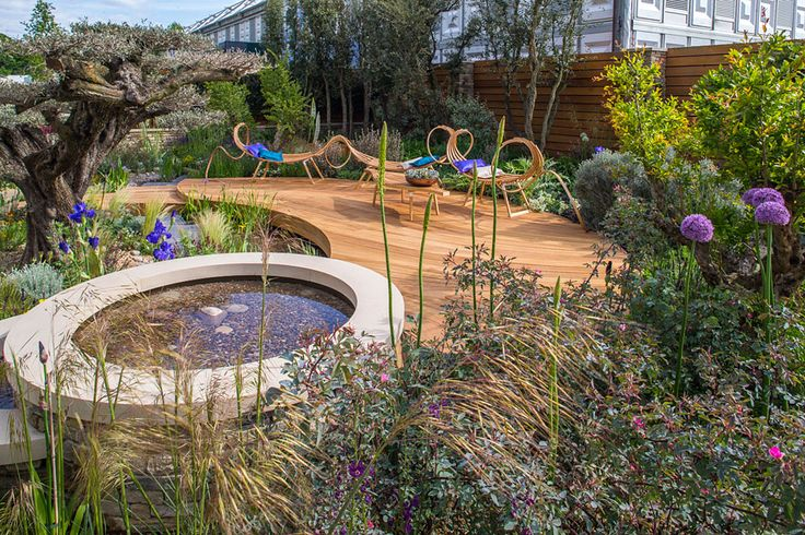 The Tom Raffield curly bench in the The Royal Bank of Canada Garden at the Chelsea Flower Show / RHS Gardening