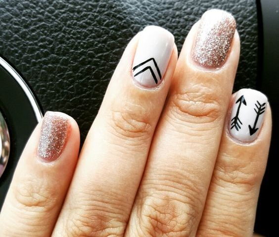 Nail design with accent nails - nude, glitter and arrows