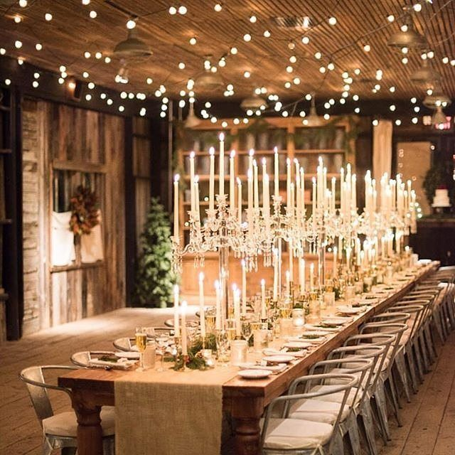 A romantic reception dazzles us with it's elegant decor and warm candle light. Photo: @sweetrootvillage | Planning: @strawberrymilkevents | Venue: @terrain_weddings | Bride: @kayannesavage