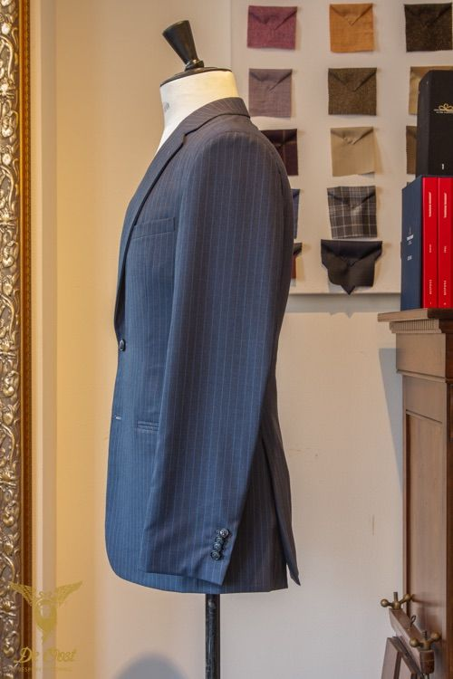 Inky blue with blue guarded striped suit with notched lapels. Bespoke tailored with 100 percent Super 100's worsted light weight suiting fabric from the Cape Horn Lightweight High Twist collection by Holland & Sherry. The fabrics in this collection do not crease excessively, are breathable and are perfect for warmer climates. 260 gram, 8 oz.
