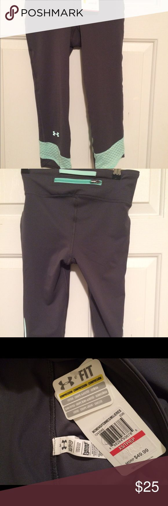 Under Armor grey and mint Capri leggings NWT size XS women's compression heat gear Capri leggings. Love these but was given the wrong size. Under Armour Pants Track Pants & Joggers