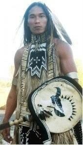 Another photo of the unknown handsome dancer -- this one you can see his dance shield