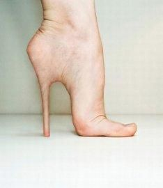 stiletto heel implants now this is gross and uncomfortable looking