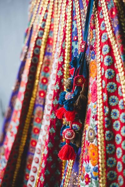Bridal Details - Bridal Threadwork Sabyasachi Lehenga with Red and Blue Pom-Poms…