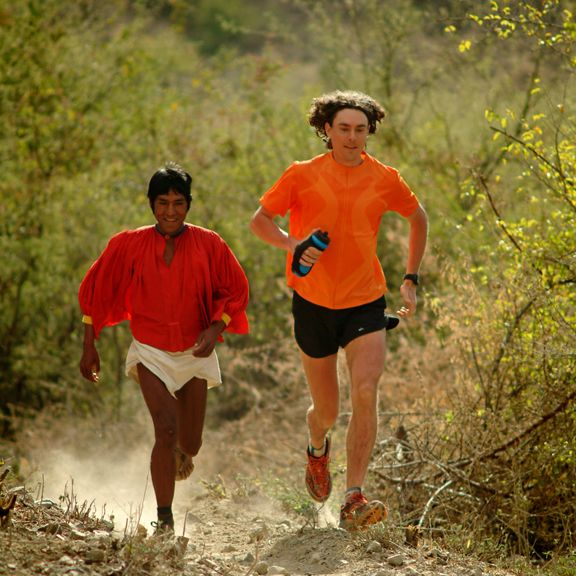 "Tarahumara runner Arnulfo Quimare and American Scott Jurek in the race described in Chris MacDougall's book ""Born to Run"""