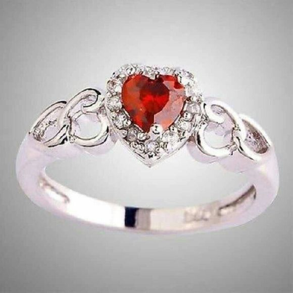 Brand New Beautiful Ruby Colored Heart Ring Brand New Beautiful Ruby Red Colored Heart Shaped Ring With White Topaz Accents  This Ring Is Stamped With 925 Inside The Band Of Ring AS U CAN SEE BY THE PICTURES I'VE ADDED!!  ▫Center Stone: Simulation Ruby CZ / AAA Grade Cz  ▫Stone Size: 6*6mm  ▫Around The Ruby Heart Are Several Smaller Simulation Diamond CZ Stones/ White Topaz  ▫Band Size: 2mm  ▫Ring Top Size: 9mm Wide  ▫Weight Approx: 3 grams   ▫Plating Color: White Gold/Silver Unknown Jewelry…