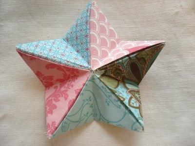 Origami star using fabric... good for ornaments!
