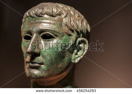 Madrid, Spain - July 11, 2016: Roman head of bronze statue with empty eyes at National Archaeological  Museum of Madrid