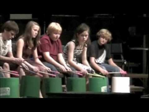 Fabulous!  bucket drumming steady start. concentrating throughout. lifting up drums. soloing