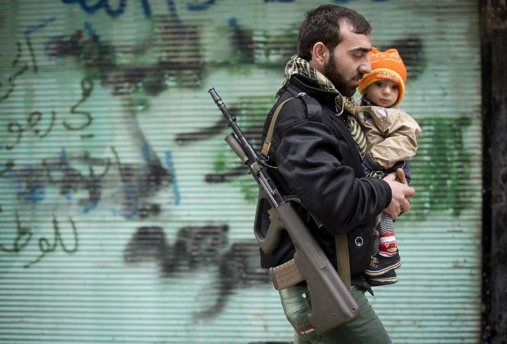 The Week in Pictures | Dec. 3 to Dec. 10, 2012 - Visual Storytelling from the Los Angeles Times. Aleppo, Syria — A rebel fighter carries his son after Friday prayers.