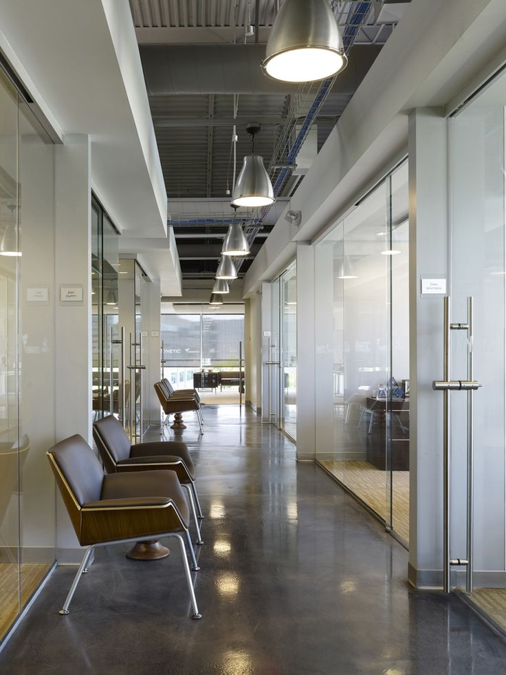 cool office space ideas. idea of what concrete hallways with carpeted offices would look like herman miller swoop chairs cool office space ideas