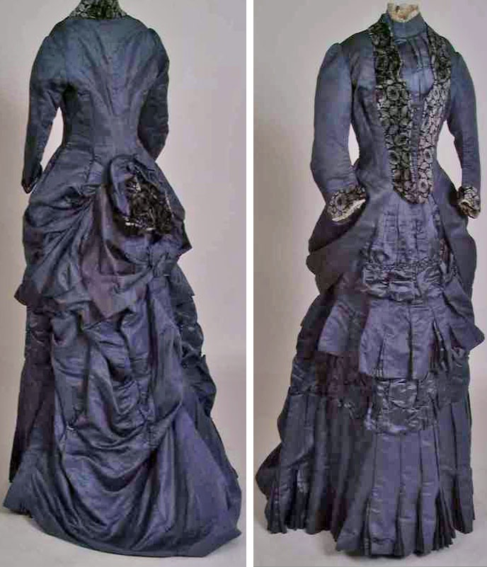 Dress, Maison Moris, Paris, no date but I'm guessing 1880s. Two pieces, silk and silk velvet. Draped, ruffled, and pleated, with velvet trimming, recessed buttons, and machine lace. Norwegian Folk Museum