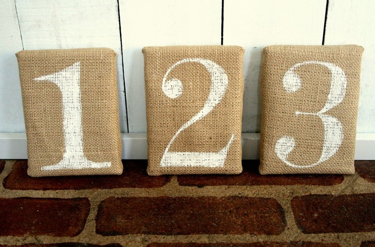 cover a brick or make a bean filled pillow, spray paint number or letter...Door stopper...Burlap