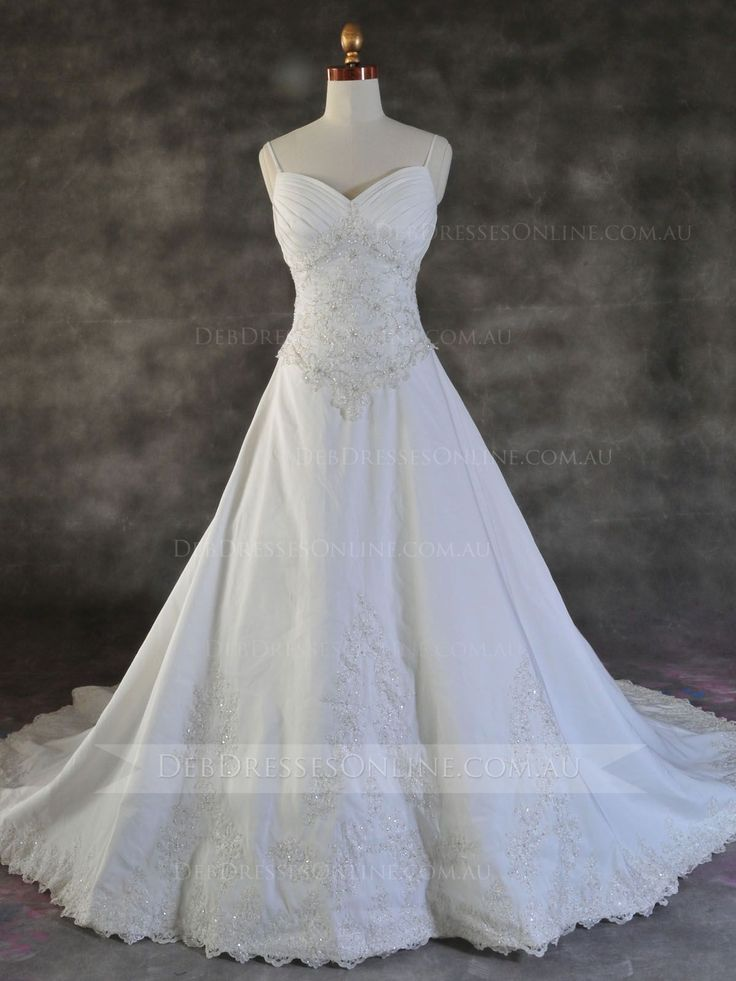 Embellished lace on satin is gracefully displayed in this classic and modest presentation, beautifully enhanced by scattered Swarovski crystals and pleated sweetheart neckline with spaghetti straps. Finished with a zipper back closure. #debutantegown #spaghettistrapsdebdress #vintagedebdress #debdressesonline  #debdresses  #debdressshop  #debutante #debutantes2016  #debutanteball #debdressesmelbourne