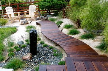 Guided Gardens: Beautiful Wooden Pathways. This was a mangaris walkway sealed with penofin hardwood stain. The planks were custom made and each piece was tapered to achieve the curves. Fasteners were plugged for a blind fastened appearance.