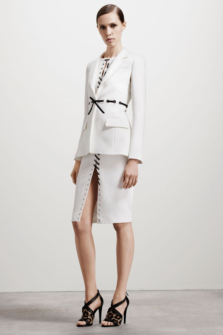 Altuzarra; we love the stitching up the dress from both directions, and the slightly more tailored jacket to bring it all together. Extremely versatile, which is the greatest appeal of all!