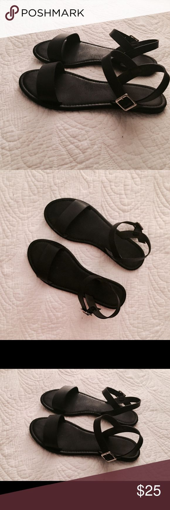 Solid black flat sandals Black flats, size 8.5 (unmarked). Worn once or twice. Thick front strap and sturdy adjustable back strap. In great condition! Shoes Sandals