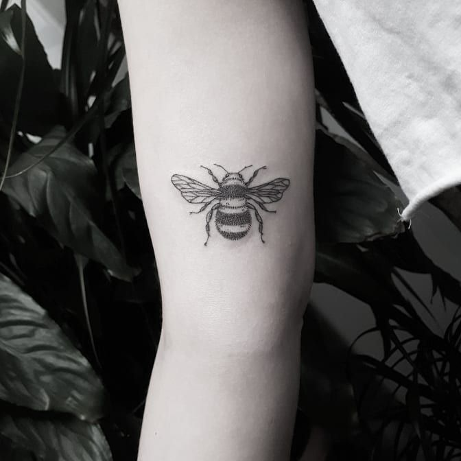 Small Black And Grey Bee Tattoo On The Right Arm Bee Tattoo Black Ink Tattoos White Tattoo