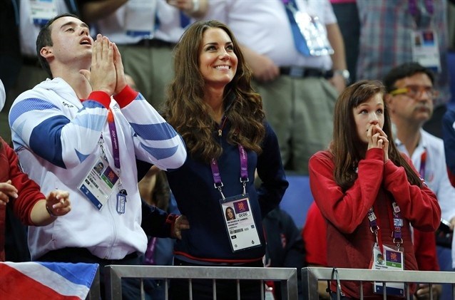 Princess Kate is seen with British gymnasts Rebecca Tunney and Kristian Thomas as they attend the gymnastics finals on day 9.