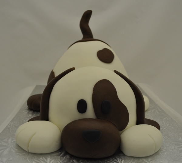 """Instructions: He is made using the wilton wonder mold for his bum and the 1/2 ball pan with a 6"""" round under it for the head. Covered in fondant and then ears, tail, snout and paws solid fondant :)  poky puppy cake!"""