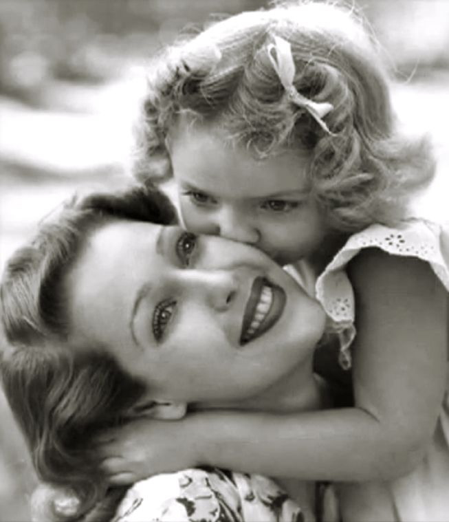 "Loretta Young & daughter Judy Lewis (child of Clark Gable) ~ Loretta hid her pregnancy after having an affair with Gable while filming ""Call of the Wild"" (1934)."