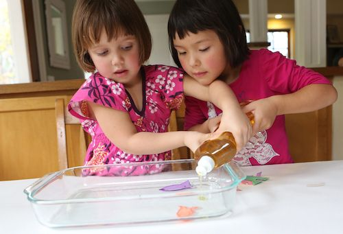 Find out how to teach your kids a little science with some paper fish and a pan of water.