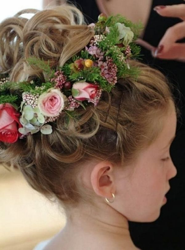 Flower Girl Hairstyles leading the bride into the ceremony the flower girl has a pretty important part in the wedding all eyes will be on the adorable girl walking down the Flower Girl Hairstyle With Floral Halo