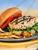Oprah's Turkey Burger - a classic for a reason!  •1/4 cup thinly sliced scallions   •1/2 cup finely chopped celery   •3 Granny Smith apples , peeled and diced   •1/8 cup canola oil   •4 pounds ground turkey breast   •2 Tbsp. salt   •1 Tbsp. black pepper   •2 tsp. Tabasco® chipotle pepper sauce   •1 lemon , juiced and grated zest   •1/2 bunch parsley , finely chopped   •1/4 cup Major Grey's Chutney , pureed