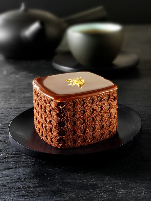A modern designed cake with a sponge case and chocolate filling in a Traditionl…