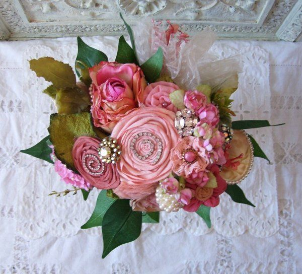 Looking for an alternative to fresh flowers?  A keepsake bridal bouquet made of fabric ribbon roses, vintage brooches, pearls and tulle; this bouquet would look just as lovely on your tenth anniversary as it did on your wedding day. Posted from WeddingWire.com.