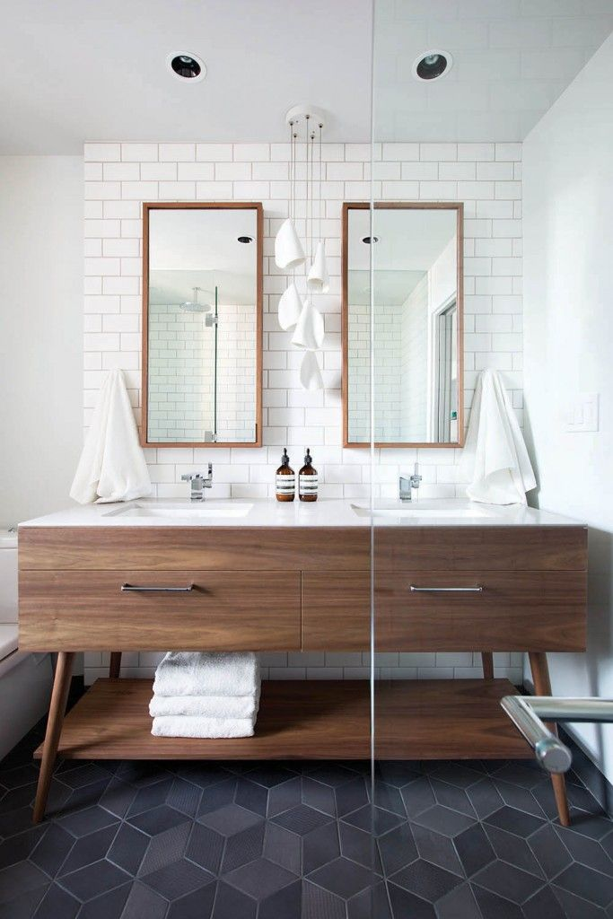 LOVE this custom piece that looks more like furniture than a bathroom vanity! Also love the mirrors!