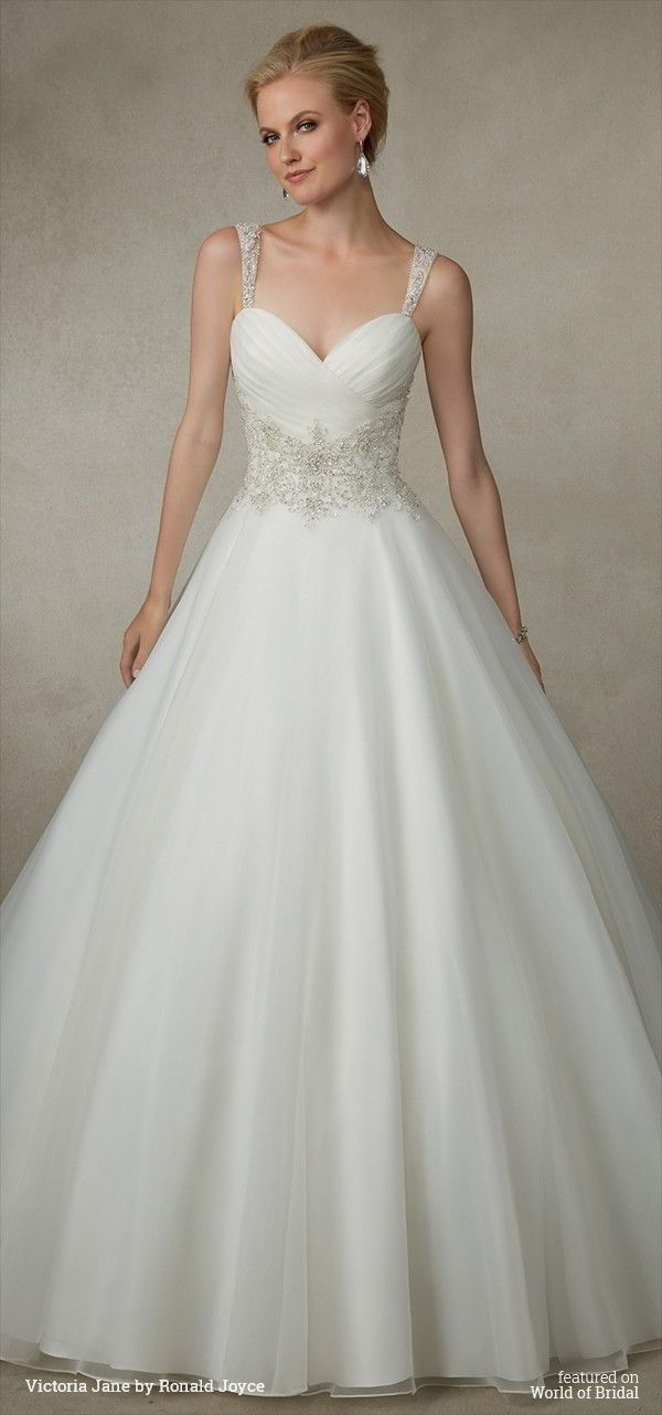 An organza ball gown with beaded waistband, beaded straps and a unique illusion back