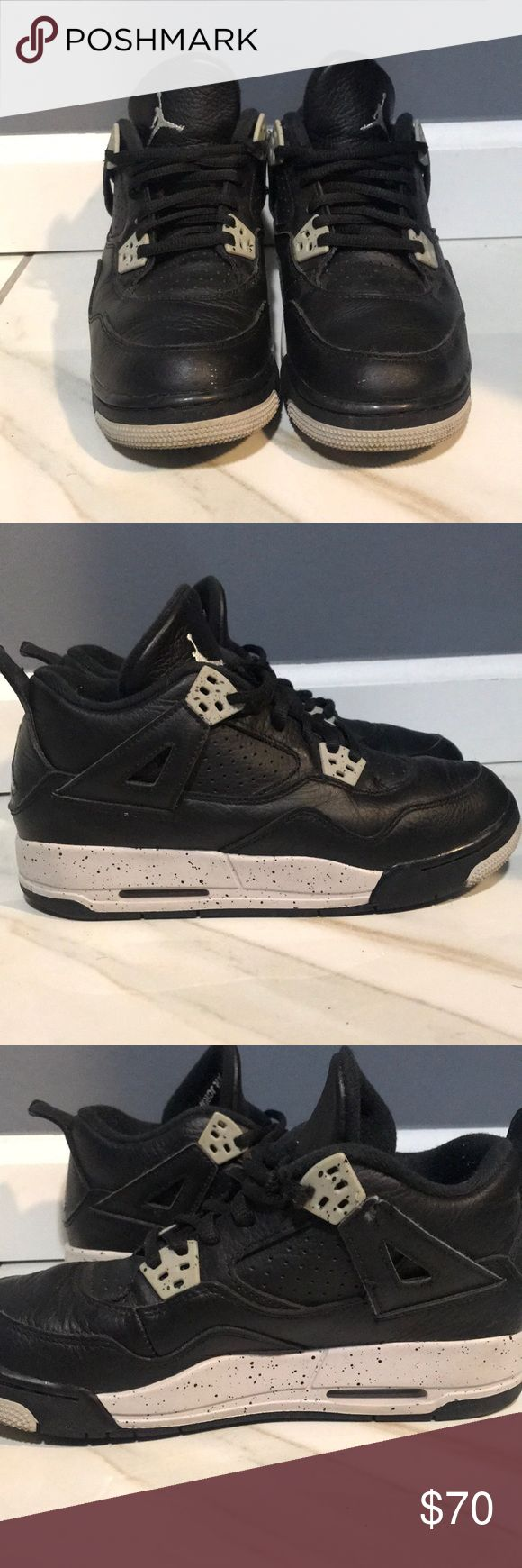 Air Jordan Retro 4 Air Jordan retro 4 (oreo) . Size 5 Y. Slightly used . Unfortunately my puppy got ahold of them and slightly nibbled on the left sneaker (see picture 3) Jordan Shoes Sneakers