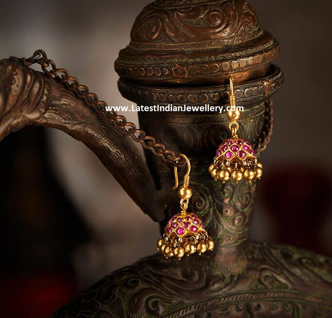 Burmese rubies hoop style earrings and ruby jhumkas from NAC jewellers old gold antique collection with gold ball drops.