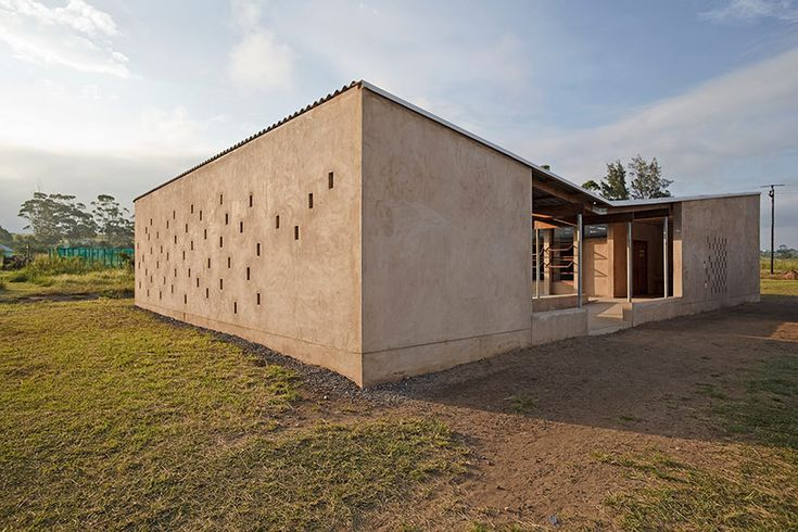 mzamba preschool and grade 1 buildings, mzamba, south africa by bauen fur orange farm: a building that is born out of its surroundings is always sustainable!