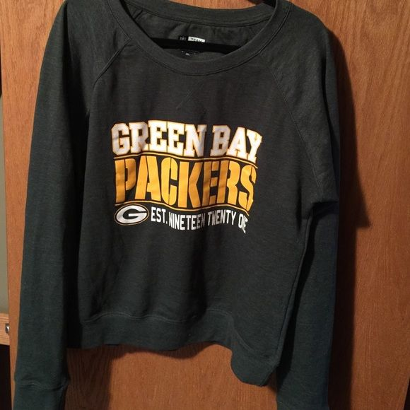 NFL apparel womens Green Bay packer sweatshirt NFL women's packer sweatshirt. Sweatshirt is green with white and yellow writing. Size is XXL but fits like a XL. Only worn once. NFL Team Apparel Tops Sweatshirts & Hoodies