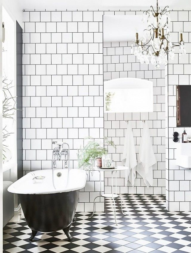 Scandinavian bathroom with a traditional bathtub and black-and-white checkerboard floors