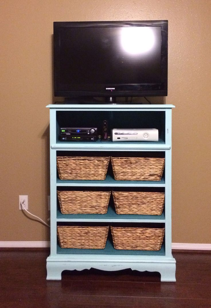 Upcycle an old dresser with broken drawers into storage for tv and Xbox clutter