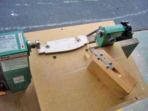 Duplicator - Homemade duplicator constructed from lumber, a cutting bit, and screws.