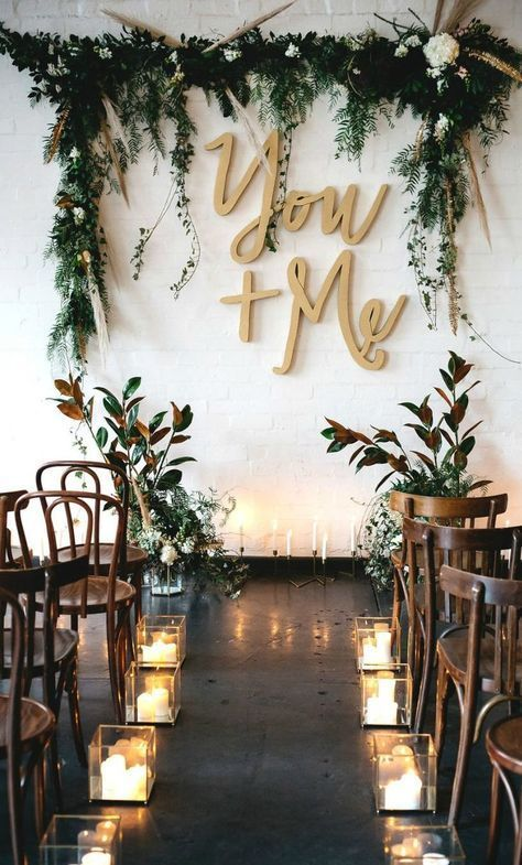 """Searching for something untraditional to decorate the altar of your wedding ceremony? Look no further than this charming """"You and Me"""" gold wall art! Plus, when paired with dripping vines and gorgeous flowers, your big day will be as special as it is stylish."""