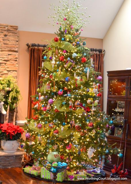 A Colorful Christmas Tree..ours looks like this a little, we are adding green ribbon as well